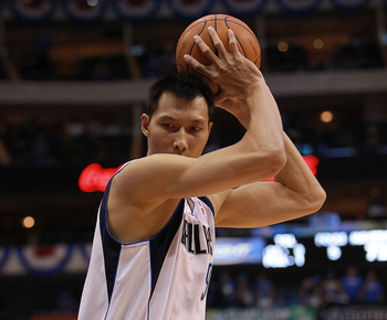 DALLAS, TX - MAY 03:  Yi Jianlian #9 of the Dallas Mavericks during Game Three of the Western Conference Quarterfinal at American Airlines Center on May 3, 2012 in Dallas, Texas.  NOTE TO USER: User expressly acknowledges and agrees that, by downloading a
