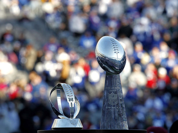 EAST RUTHERFORD, NJ - FEBRUARY 07:  The George Halas Trophy for the NFC Championship and the Vince Lombardi Trophy are displayed at a rally to celebrate the New York Giants' Super Bowl victory at MetLife Stadium on February 7, 2012 in East Rutherford, New
