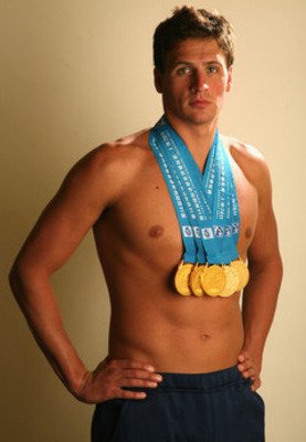Lochte poses with his Olympic Gold medals.