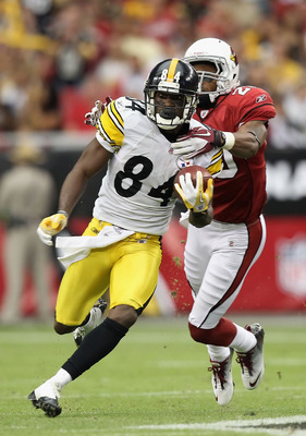 GLENDALE, AZ - OCTOBER 23:  Wide receiver Antonio Brown #84 of the Pittsburgh Steelers runs with the football after a reception past A.J. Jefferson #20 of the Arizona Cardinals during the NFL game at the University of Phoenix Stadium on October 23, 2011 i