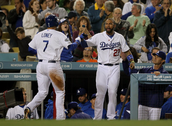 LOS ANGELES, CA - MAY 12:  James Loney #7 of the Los Angeles Dodgers is greeted at the dugout by Matt Kemp #27 after Loney scored the go ahead run in the eighth inning against the Colorado Rockies on May 12, 2012 at Dodger Stadium in Los Angeles, Californ