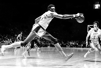 Photo Source: L.A. Times (http://latimesblogs.latimes.com/sports_blog/2011/03/lakers-moments-wilt-chamberlain-stretches-out.html)
