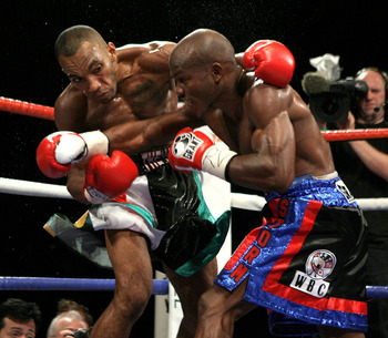 NOTTINGHAM, ENGLAND - MAY 10:  Timothy Bradley (L) connects with a right cross on Junior Witter during their WBC Light Welterweight fight on May 10, 2008 at Nottingham Ice Arena in Nottingham, England. (Photo by John Gichigi/Getty Images)