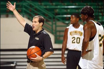 New head coach Scott Drew with 2004 player Tim Bush in the background. Courtesy of ljworld.com