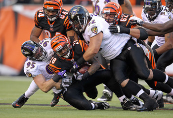 CINCINNATI, OH - JANUARY 01:  Bernard Scott #28 of the Cincinnati Bengals runs with the ball while tackled by Jarret Johnson #95 and Haloti Ngata #92 of the Baltimore Ravens during the NFL game at Paul Brown Stadium on January 1, 2012 in Cincinnati, Ohio.