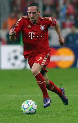 MUNICH, GERMANY - APRIL 03:  Franck Ribery of Muenchen runs with the ball during the UEFA Champions League quarter-final second leg match at Allianz Arena on April 3, 2012 in Munich, Germany.  (Photo by Martin Rose/Bongarts/Getty Images)