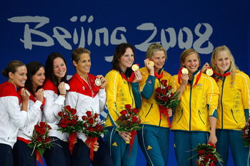 Coughlin's relay team helped her earn her sixth Beijing medal.