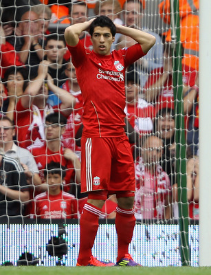 Luis Suarez reacts after his penalty miss in the season opener vs. Sunderland.