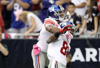 Hakeem Nicks celebrates a game-winning TD catch with a teammate.