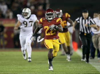 LOS ANGELES, CA - NOVEMBER 26:  Running back Curtis McNeal #22 of the USC Trojans breaks away on a 73 yard touchdown run in the first quarter against the UCLA Bruins at the Los Angeles Memorial Coliseum on November 26, 2011 in Los Angeles, California.  (P