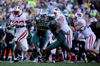 Montee Ball breaks away from Oregon's defense in the Rose Bowl.