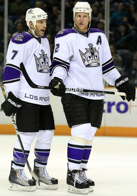 Kings defensemen Rob Scuderi (left) and Matt Greene (right) have found a way to shut down the opposition this postseason.
