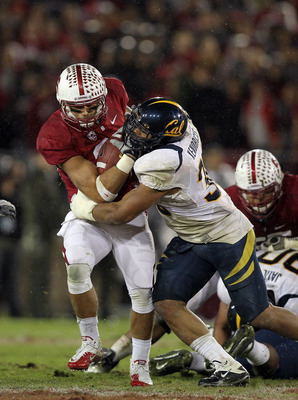 STANFORD, CA - NOVEMBER 19:  Tyler Gaffney #25 of the Stanford Cardinal is tackled by Mychal Kendricks #30 of the California Golden Bears during their game at Stanford Stadium on November 19, 2011 in Stanford, California.  (Photo by Ezra Shaw/Getty Images