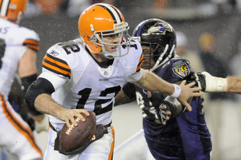 CLEVELAND, OH - DECEMBER 4: Quarterback Colt McCoy #12 of the Cleveland Browns scrambles under pressure during the third quarter against the Baltimore Ravens at Cleveland Browns Stadium on December 4, 2011 in Cleveland, Ohio. The Ravens debated the Browns