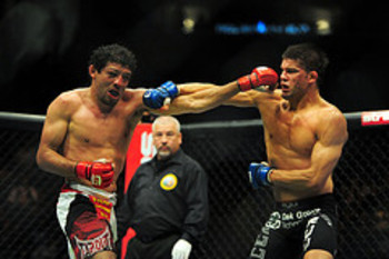 Gilbert Melendez and Josh Thomson - Kyle Terada/US PRESSWIRE