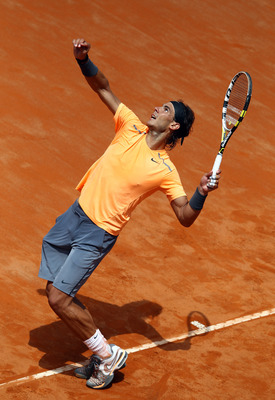 ROME, ITALY - MAY 21:  Rafael Nadal of Spain serves to Novak Djokovic of Serbia in the final during day ten of the Internazionali BNL d'Italia 2012 Tennis on May 21, 2012 in Rome, Italy.  (Photo by Julian Finney/Getty Images)
