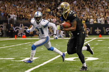 NEW ORLEANS, LA - DECEMBER 04:  Wide receiver Robert Meachem #17 of the New Orleans Saints runs past cornerback Eric Wright #21 of the Detroit Lions after a catch for a 67 yard touchdown at Mercedes-Benz Superdome on December 4, 2011 in New Orleans, Louis