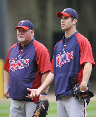 "Ron ""Gardy"" Gardenhire (left) and Joe Mauer."