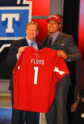 First-round pick Michael Floyd poses with Commissioner Roger Goddell at the NFL Draft.