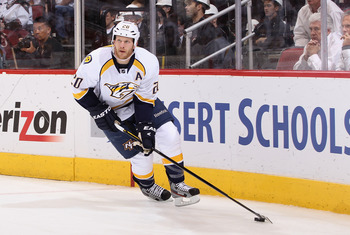 GLENDALE, AZ - MAY 07:  Ryan Suter #20 of the Nashville Predators skates with the puck in Game Five of the Western Conference Semifinals against the Phoenix Coyotes during the 2012 NHL Stanley Cup Playoffs at Jobing.com Arena on May 7, 2012 in Glendale, A