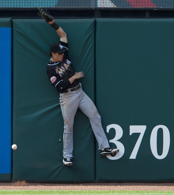 CLEVELAND, OH - MAY 20: Left fielder Chris Coghlan #8 of the Miami Marlins can't make the catch off an RBI double hit by Jose Lopez #4 of the Cleveland Indians during the ninth inning of an inter-league game at Progressive Field on May 20, 2012 in Clevela