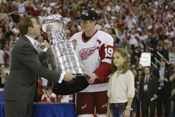 DETROIT, MI - JUNE 13:  Commisioner Gary Bettman presents the Stanley Cup to captain Steve Yzerman of the Detroit Red Wings with his daughter Isabella after eliminating the Carolina Hurricanes during game five of the NHL Stanley Cup Finals on June 13, 200