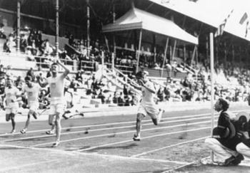 Ralph Craig crosses the line to take gold in the 100-meter dash. (IOC photo)