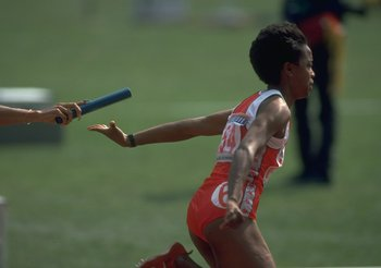 Evelyn Ashford takes the baton from Florence Griffith Joyner in Seoul.