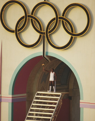 Rafer Johnson lights the Olympic torch at the 1984 Olympics.