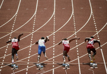 Carl Lewis, far left, at the start of the 100 meters in Seoul.