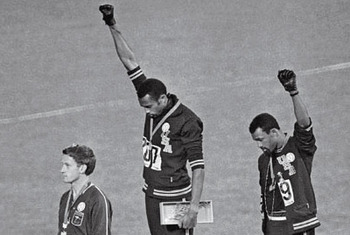 Tommie Smith and John Carlos raise their fists in Mexico City. (AP photo)