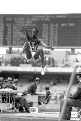 Bob Beamon reached broke the world record by nearly two feet.