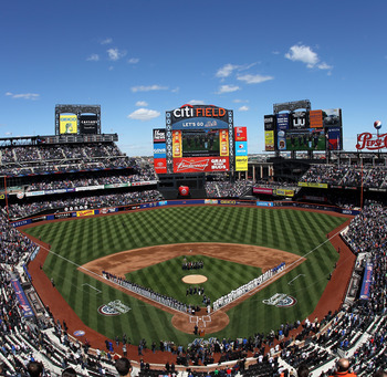 NEW YORK, NY - APRIL 05:  A general view of players and coaches from the New York Mets and the Atlanta Braves  lined up on the foul line for the performance of the National Anthem during their Opening Day Game at Citi Field on April 5, 2012 in New York Ci