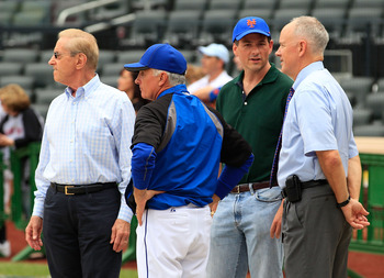 NEW YORK - AUGUST 06:  New York Mets Chief Executive Officer Fred Wilpon , Manager Terry Collins, prospective Mets owner David Einhorn and General Manager Sandy Alderson (L-R) talk during batting practice before a Major League Baseball game against the At