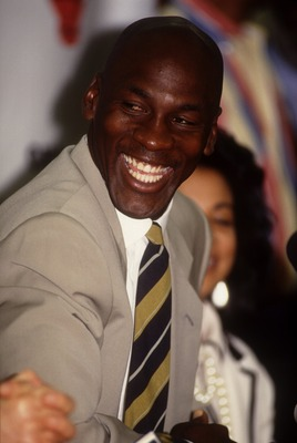Michael Jordan laughs during the press conference announcing his retirement from the NBA Chicago Bulls. Mandatory Credit: Jonathan Daniel/ALLSPORT