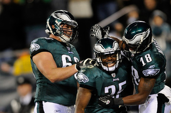 PHILADELPHIA, PA - DECEMBER 18:   LeSean McCoy #25 of the Philadelphia Eagles celebrates with his teammates Jeremy Maclin #18 and Danny Watkins #63 after scoring a touchdown against the New York Jets at Lincoln Financial Field on December 18, 2011 in Phil