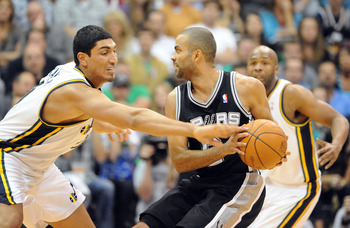 SALT LAKE CITY, UT  - MAY 5: Enes Kanter #0 of the Utah Jazz reaches in on Tony Parker #9 of the San Antonio Spurs during the third quarter of Game Three of the Western Conference Quarterfinals in the 2012 NBA Playoffs at EnergySolutions Arena on May 05,