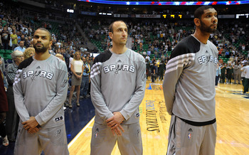 SALT LAKE CITY, UT - MAY 07: (L to R) Tony Parker #9, Manu Ginobili #20 and Tim Duncan #21 of the San Antonio Spurs stand during the national anthem before Game Four of the Western Conference Quarterfinals against the Utah Jazz in the 2012 NBA Playoffs at