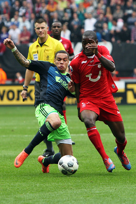 Gregory Van Der Wiel could bring a different dimension to Liverpool.