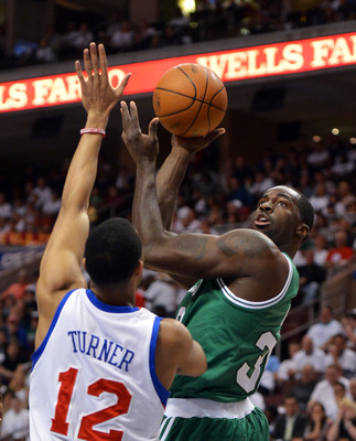 Evan Turner tries to block a Brandon Bass shot in Game 5.