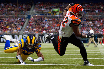 ST. LOUIS, MO - DECEMBER 18: Cedric Benson #32 of the Cincinnati Bengals scores a touchdown against Josh Gordy #38 of the St. Louis Rams at the Edward Jones Dome on December 18, 2011 in St. Louis, Missouri.  The Bengals beat the Rams 20-13.  (Photo by Dil