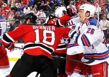 Game 3: Steve Bernier tussles with Rangers forward Ruslan Fedotenko.