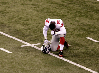 INDIANAPOLIS, IN - FEBRUARY 05:  Prince Amukamara #20 of the New York Giants kneels on the field after defeating the New England Patriots in Super Bowl XLVI at Lucas Oil Stadium on February 5, 2012 in Indianapolis, Indiana. The New York Giants defeated th