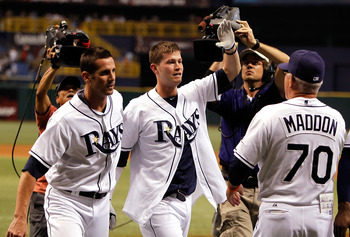 Reid Brignac celebrates after his walk-off home run gives the Rays a 1-0 win in a crucial game against the Yankees