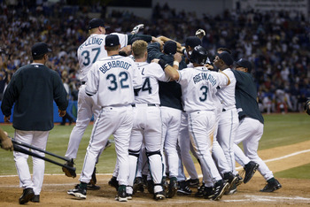The Devil Rays celebrate after Crawford's homer gives them a 6-4 win over the Red Sox