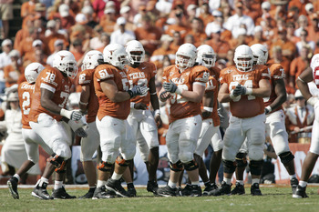 The Offensive line of the Texas Longhorns breaks the huddle against the Oklahoma Sooners in the 100th annual Red River Rivalry at the Cotton Bowl in Dallas, Texas on October 8, 2005.  Texas won 45-12. (Photo by G. N. Lowrance/Getty Images)