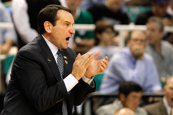 GREENSBORO, NC - MARCH 16:  Head coach Mike Krzyzewski of the Duke Blue Devils reacts in the first half while taking on the Lehigh Mountain Hawks during the second round of the 2012 NCAA Men's Basketball Tournament at Greensboro Coliseum on March 16, 2012