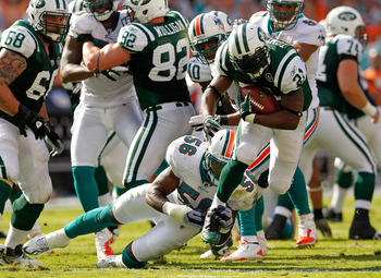 MIAMI GARDENS, FL - JANUARY 01:   LaDainian Tomlinson #21 of the New York Jets rushes during a game against the Miami Dolphins at Sun Life Stadium on January 1, 2012 in Miami Gardens, Florida.  (Photo by Mike Ehrmann/Getty Images)