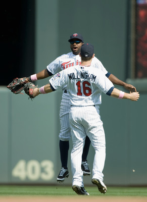 MINNEAPOLIS, MN - MAY 13: Josh Willingham #16 and Denard Span #2 of the Minnesota Twins celebrate a win against the Toronto Blue Jays on May 13, 2012 at Target Field in Minneapolis, Minnesota. The Twins defeated the Blue Jays 4-3. (Photo by Hannah Foslien
