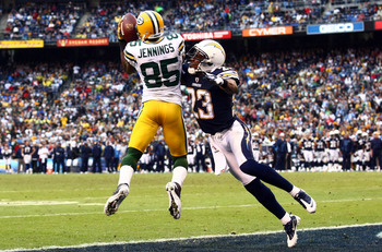 Greg Jennings going up to make the catch over Quentin Jammer
